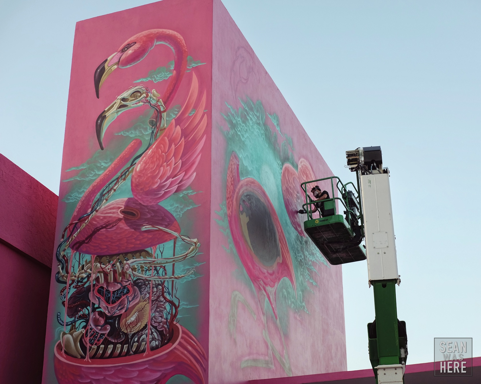 Austrian artist Nychos at work on a giant mural on Miami Ad School's brand new location in Wynwood (moving from South Beach). Wynwood Miami
