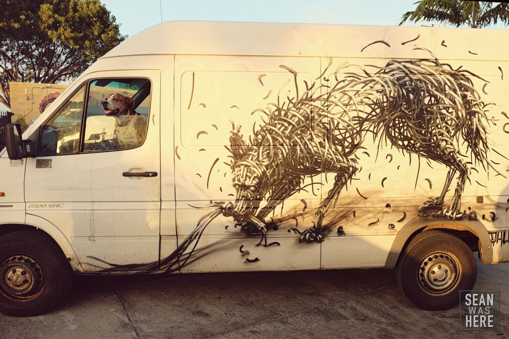 "DALeast (left) painted this van in NYC over the summer. Todd (owner) drove down from NYC for art basel. Todd: ""Yea I'm not sure how long I'll stay in town since I have a place here"". Me: ""Oh you live nearby??"" Todd: ""I live in this van!"" Wynwood Miami"
