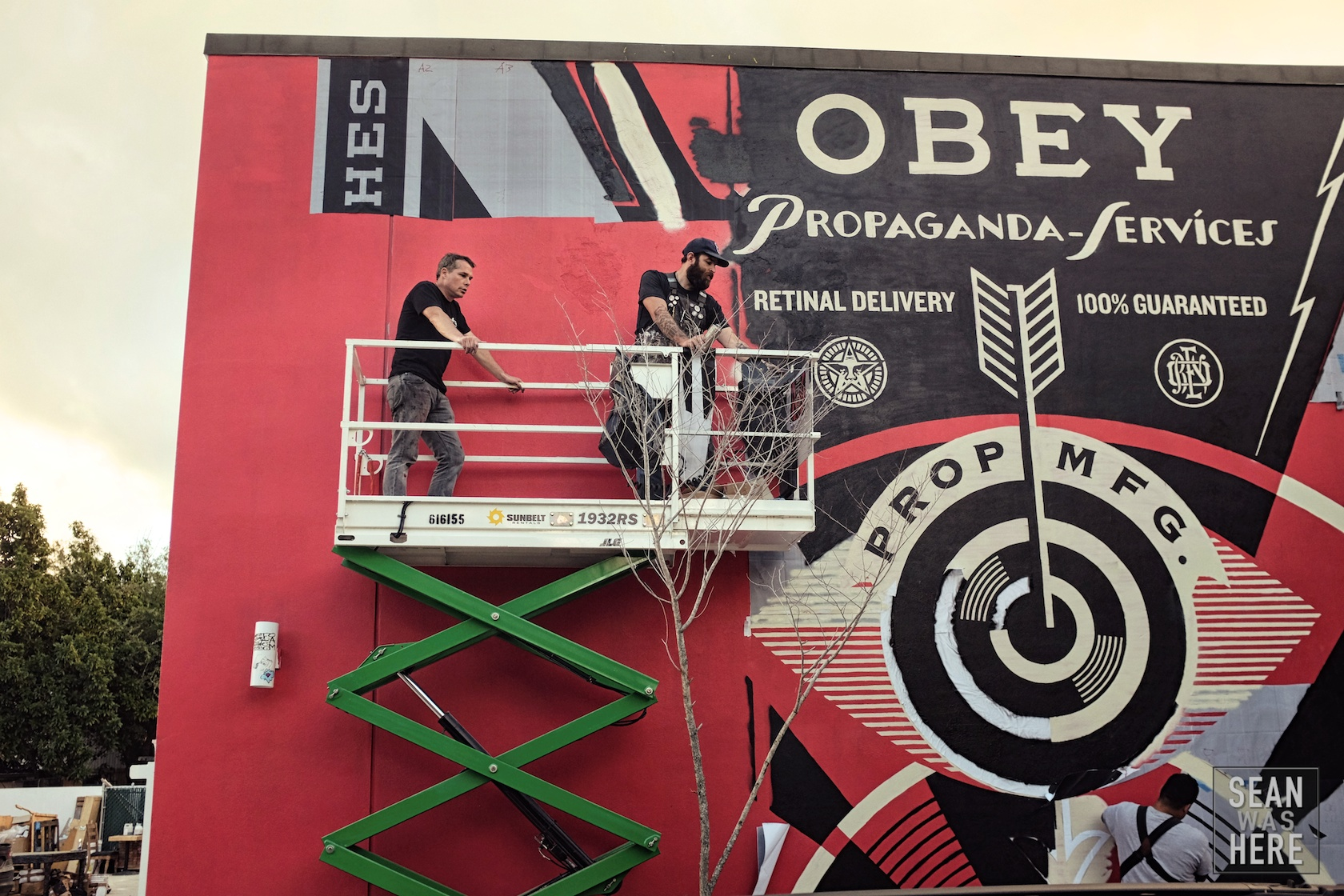 Shepard Fairey (OBEY) with his mural in progress. Wynwood Miami