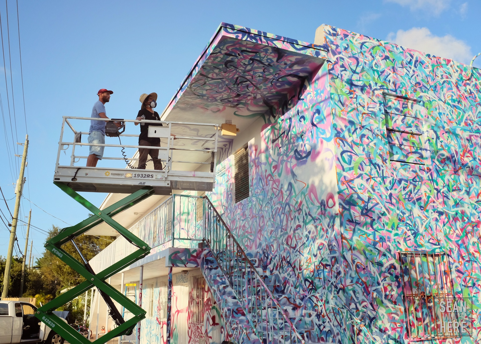 Rafael Sliks, from São Paulo Brazil, painting an entire multi-unit house with some crazy style. Wynwood Miami