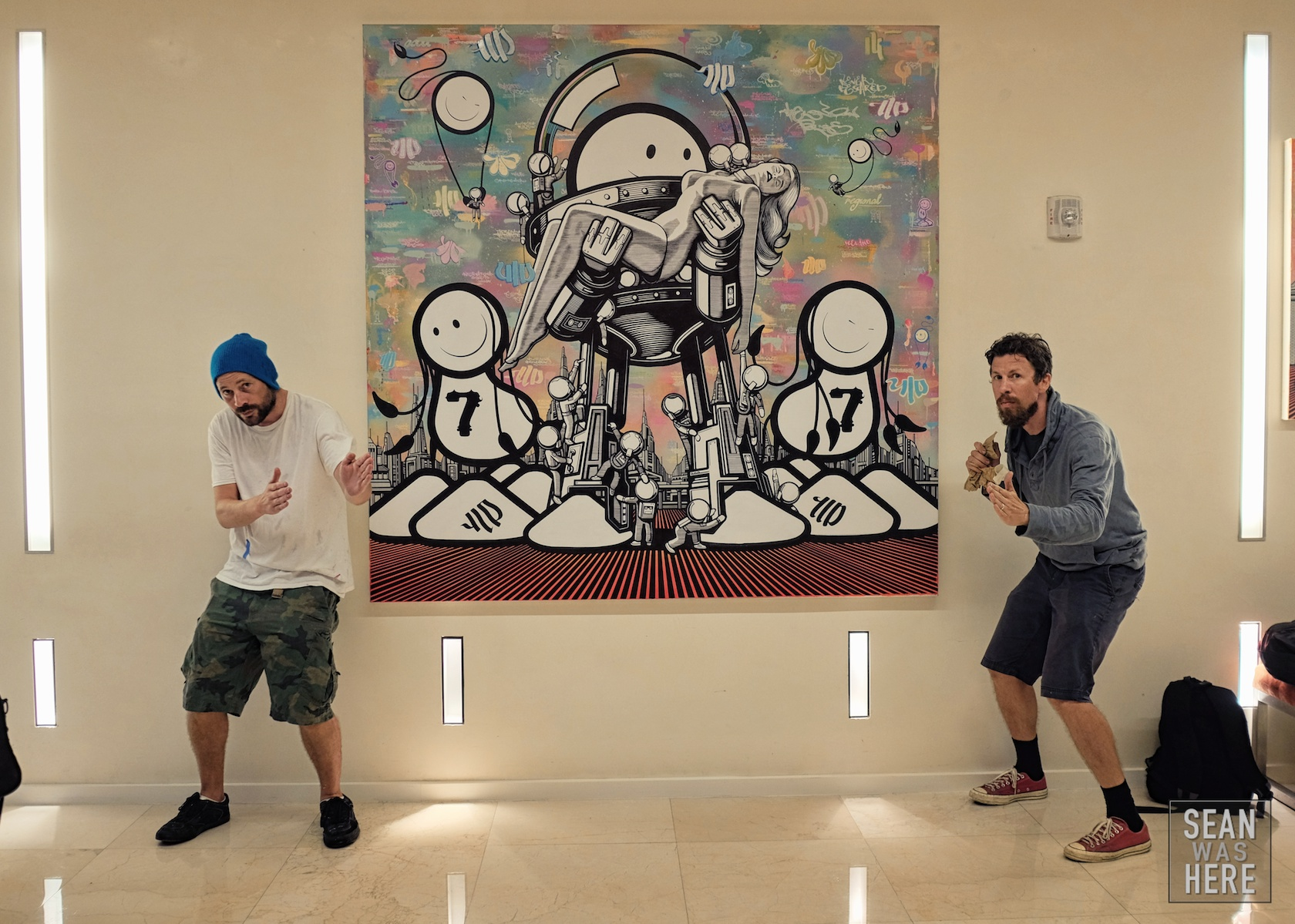 Chaz and Bob of The London Police with their amazing canvas on display at the Boulan Hotel. Miami Beach